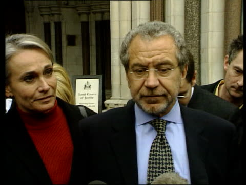 ann john england london ext ms sir alan sugar towards from court with wife following libel victory sir alan sugar press conference sot today is not... - alan sugar stock videos & royalty-free footage