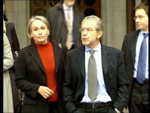 den john england london ext ms sir alan sugar towards from court with wife following libel victory sir alan sugar press conference sot today is not... - alan sugar stock videos & royalty-free footage