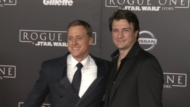 Alan Tudyk and Nathan Fillion at 'Rogue One A Star Wars Story' World Premiere at the Pantages Theatre on December 10 2016 in Hollywood California