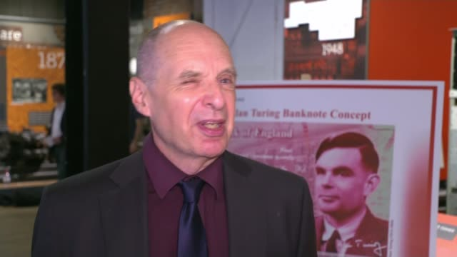 alan turing to be new face of fifty pound note england manchester science and industry museum andrew hodges with reporter and interview sot - alan turing stock videos & royalty-free footage