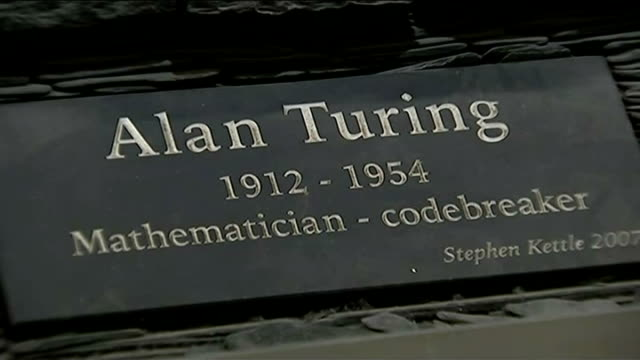 Alan Turing's family present petition to Prime Minister Slate scuplture of Alan Turing with Enigma machine 'Alan Turing 1912 1954 Mathematician...