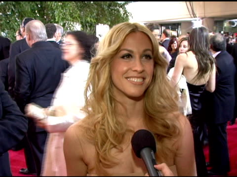 Alanis Morisette On her nomination on her dress design on rooting for Brokeback Mountain at the 2006 Golden Globe Awards Arrivals at the Beverly...