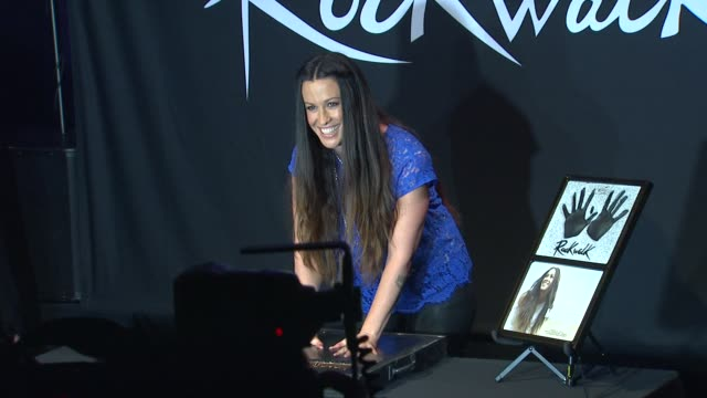 Alanis Morissette at Alanis Morissette Inducted Into Guitar Center's Historic RockWalk of Fame on 8/21/12 in Hollywood CA
