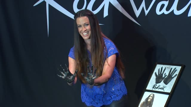 alanis morissette inducted into guitar center's historic rockwalk of fame event capsule chyron: alanis morissette inducted i at guitar center on... - alanis morissette stock videos & royalty-free footage