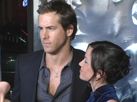 Alanis Morrisette and Ryan Reynolds at the Blade Trinity Los Angeles Premiere at Mann Graumans Chinese Theatre in Hollywood California