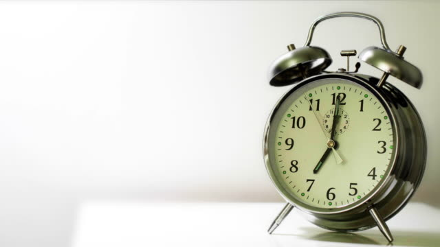 alarm clock 7am. ring with audio and copy space. - number 7 stock videos & royalty-free footage