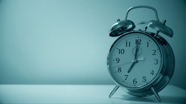 alarm clock 7am. ring with sound and copy space. - bedtime stock videos & royalty-free footage