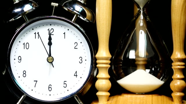 alarm clock and hourglass - time lapse - number 12 stock videos and b-roll footage