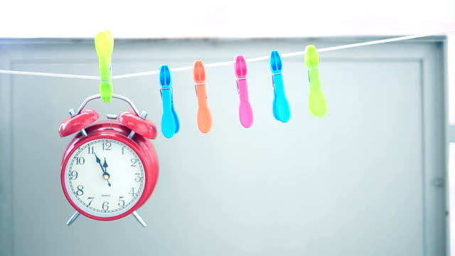 alarm clock hangs on string - clothes peg stock videos & royalty-free footage