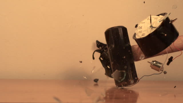 Alarm clock is smashed by sledge hammer (faster to slower)