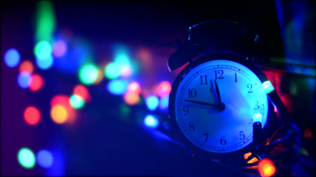 alarm clock with christmas lights, new year 2016 - wasting time stock videos & royalty-free footage