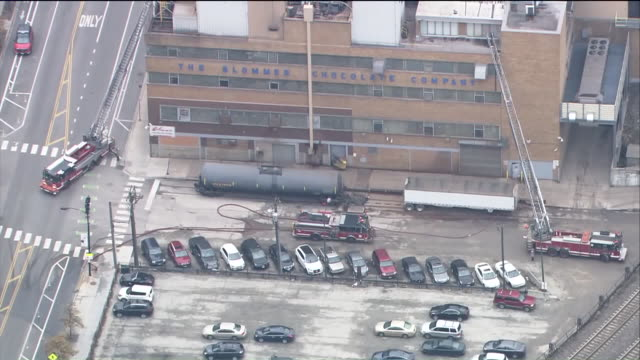 wgn a 211 alarm fire broke out at the chicago's iconic blommer chocolate factory in the 400 block of north jefferson on nov 14 2017 about 200... - chocolate factory stock videos & royalty-free footage