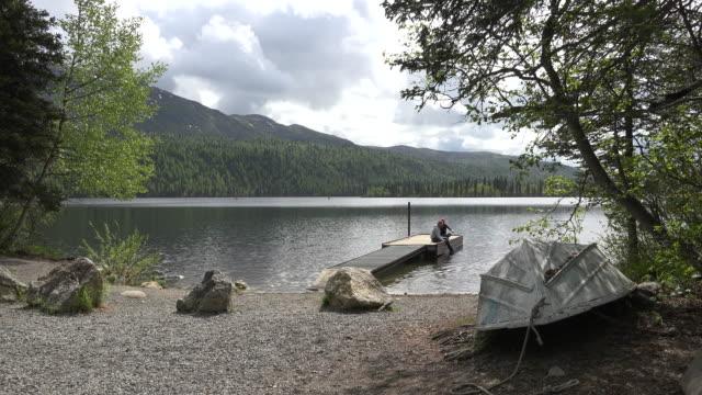 Alaska couple on dock in lake