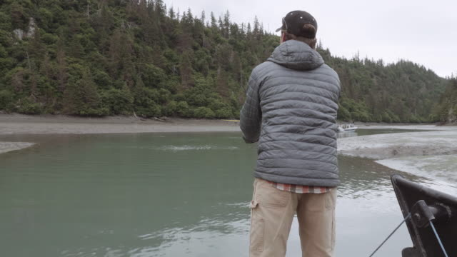 uhd 4k: alaska fisherman fishing with a pole - fishing stock videos & royalty-free footage