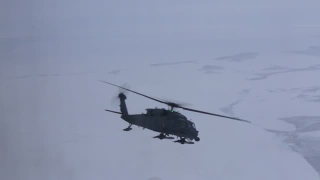 Alaska Guardsmen from the 176th Wing's 210th Rescue Squadron conduct aerial refueling of an HH60 Pave Hawk helicopter via a C130 Hercules aircraft...