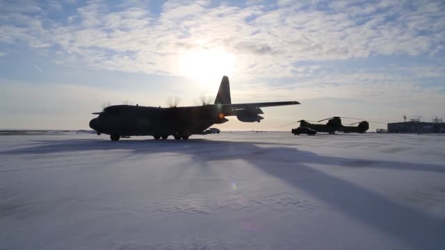 alaska guardsmen from the 176th wing's 210th rescue squadron conduct aerial refueling of an hh60 pave hawk helicopter via a c130 hercules aircraft... - military aeroplane stock videos and b-roll footage