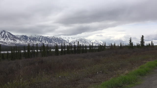 Alaska snowy mountain view zooms in