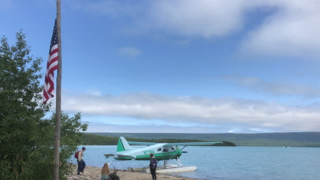 alaska tour seaplane and american flag at the katmai national park - patriotism stock videos & royalty-free footage