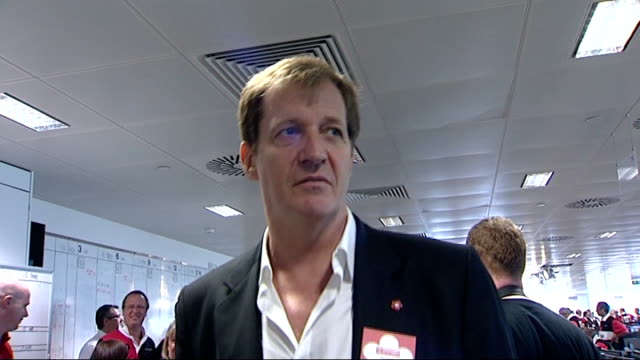 alastair campbell interview sot campbell and manchester united manager sir alex ferguson speaking on telephones in dealing room anneka rice interview... - anneka rice stock videos & royalty-free footage