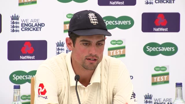 alastair cook press conference; england: london: lambeth: kennington: the oval: int alastair cook press conference sot / cook given box of beer - oval kennington stock videos & royalty-free footage