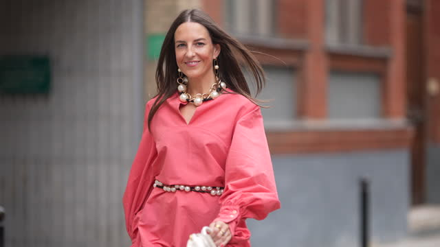 alba garavito torre wears a pink mini dress with long sleeves from natan, a pearl beaded necklace, earrings, a pearl beaded belt, a white jacquemus... - brown hair stock videos & royalty-free footage