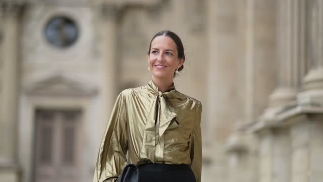 alba garavito torre wears gold pearls pendant earrings, a gold shiny puffy sleeves / knotted neck / blouse / shirt, a gold love bracelet from... - brown hair stock videos & royalty-free footage