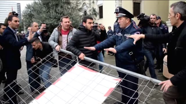 albanian demonstrators take part in a protest against a government plan to build a playground in a city park and increase in the public transport... - tirana stock videos and b-roll footage