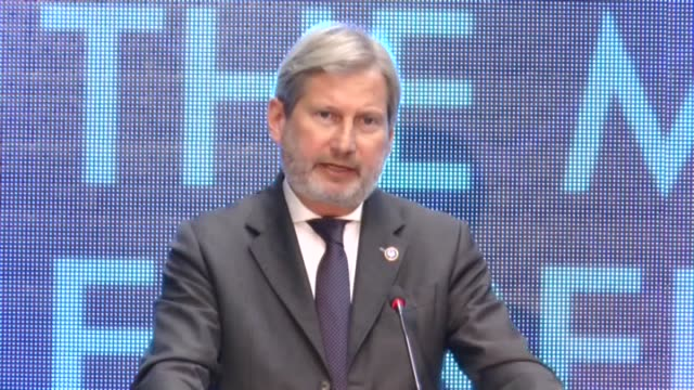 Albanian Foreign Minister Ditmir Bushati and EU Commissioner for European Neighbourhood Policy and Enlargement Negotiations Johannes Hahn hold a...