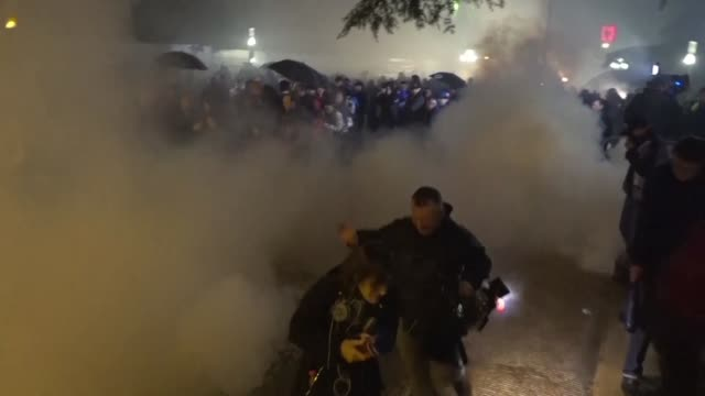 albanian police use tear gas and water cannons to disperse protesters who gathered outside the seats of parliament and government in the capital... - water cannon stock videos & royalty-free footage