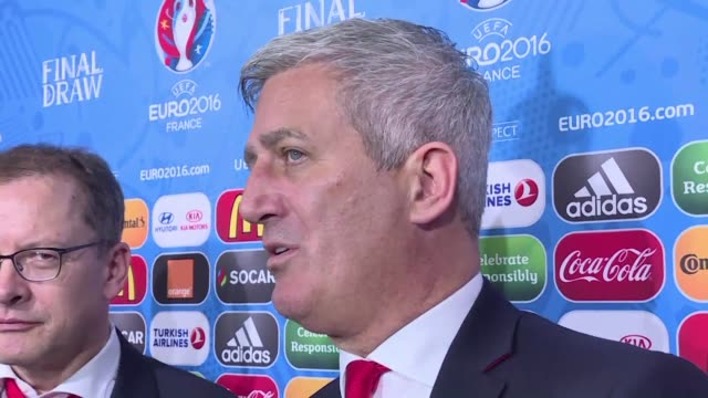 Albania's and Switzerland's coaches react to the Euro 2016 draw as they will both be part of Group A with France and Romania