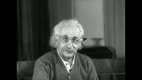 albert einstein puts on his glasses before making an address. - e=mc2 stock-videos und b-roll-filmmaterial