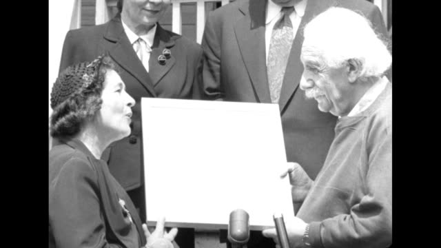 albert einstein receiving an award from the hadassah women's zionist organization of america - e=mc2 stock-videos und b-roll-filmmaterial