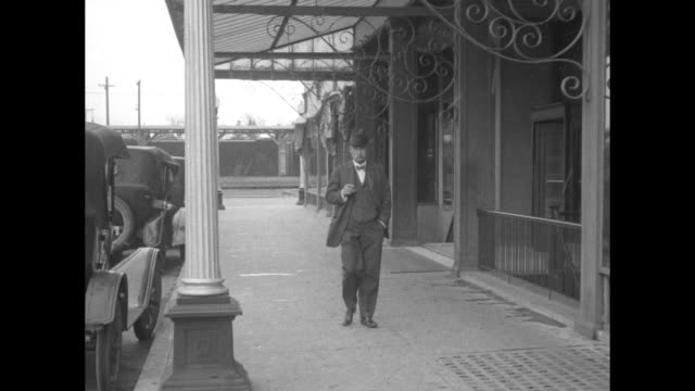 albert fall former us secretary of the interior who is implicated in the teapot dome scandal walks to camera along sidewalk he stops and poses cars... - teapot stock videos & royalty-free footage
