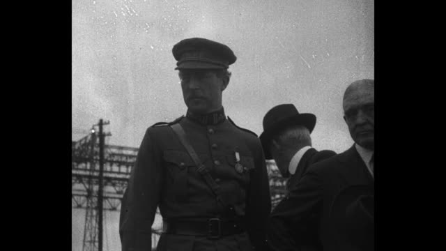 albert i followed by son leopold iii walk past camera with queen eliabeth in distance / elisabeth walks past camera / pan of concrete dry dock /... - 1910 1919 stock videos and b-roll footage