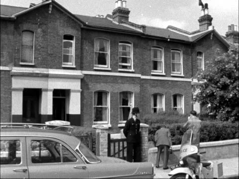 albert porritt found shot dead with two others wounded england london peckham ext police outside house men search bushes man shovels debris into bin... - peckham stock videos & royalty-free footage