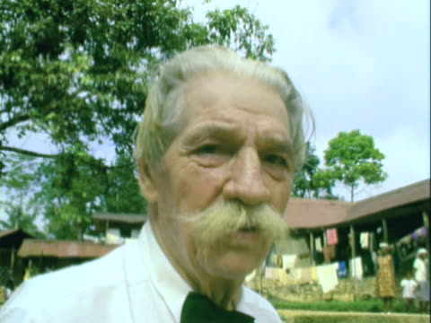 Albert Schweitzer with a bushy moustache and unkempt hair at mission hospital in Gabon