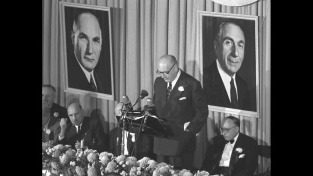albert warner speaking from the podium at the waldorf astoria for the motion picture pioneers honoring of the 3 warner brothers - warner bros. stock videos & royalty-free footage
