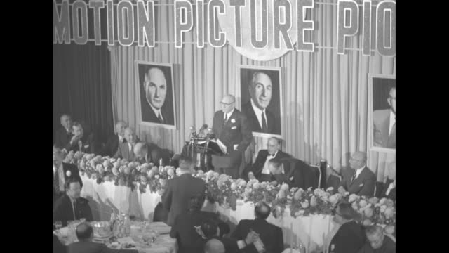 albert warner speaks as he stands at podium at head table in starlight roof banquet hall in waldorf astoria hotel his brothers jack and harry sitting... - warner bros stock videos & royalty-free footage