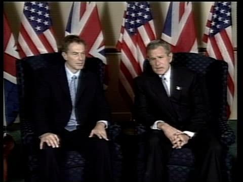 alberta: kananaskis: us president george w bush sat with british prime minister tony blair at g8 summit zoom in as george w bush speaking to press... - worldcom stock-videos und b-roll-filmmaterial