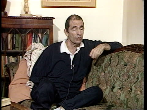 albie sachs claims south african regime responsible for car bomb; england: london: int side sachs shuffles along to sofa l-r as sits cms albie sachs... - sofa stock videos & royalty-free footage