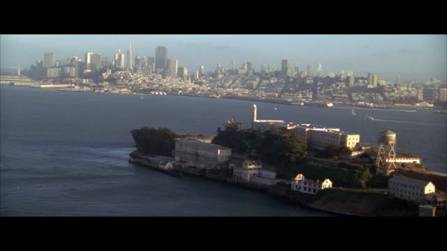 aerial alcatraz island and city skyline, san francisco, california, usa - レターボックス点の映像素材/bロール