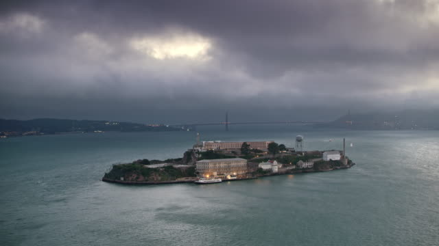 aerial alcatraz island at dusk - san francisco bay stock videos & royalty-free footage