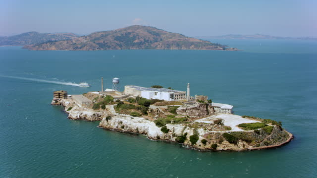 aerial alcatraz island, offshore from san francisco, ca - alcatraz island stock videos & royalty-free footage