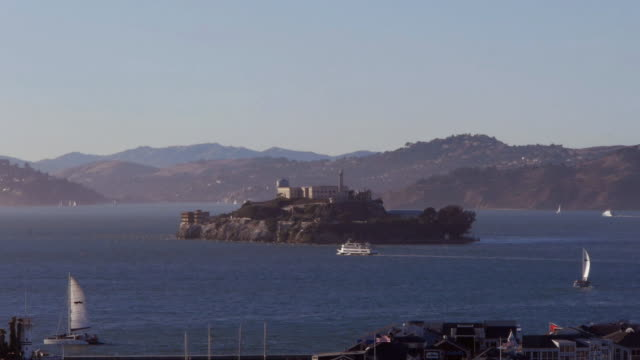 alcatraz island with ferries and sailboats in san francisco. - alcatraz island stock videos & royalty-free footage