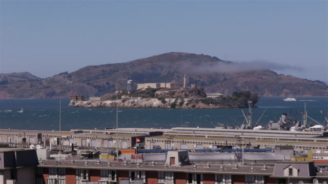 Alcatraz Island with Ferries and Sailboats with Fisherman's Wharf in foreground. San Francisco CA
