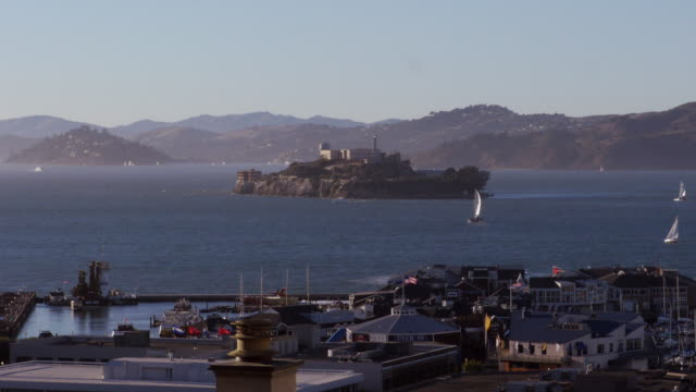 stockvideo's en b-roll-footage met alcatraz island with sailboats in san francisco.  harbor and pier 39 in foreground. - pier 39