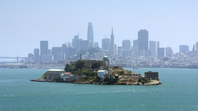 aerial alcatraz island with san francisco in the background on a sunny day - alcatraz island stock videos & royalty-free footage