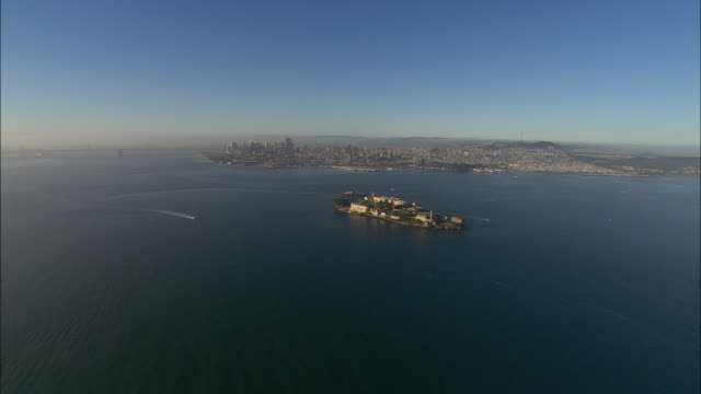 AERIAL Alcatraz Island with San Francisco skyline in background, California, USA