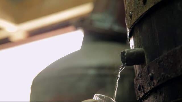 alcohol produced at traditional whisky still - distillery still stock videos & royalty-free footage