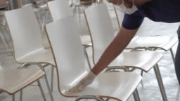 Alcohol spray and wipe a group of chairs